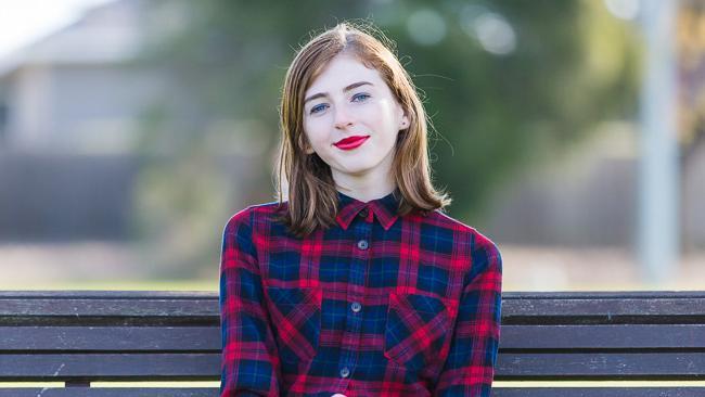 transgender teen sitting on bench